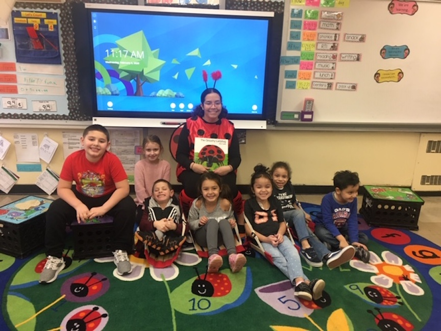 Class teacher enjoying The Grouchy Ladybug book