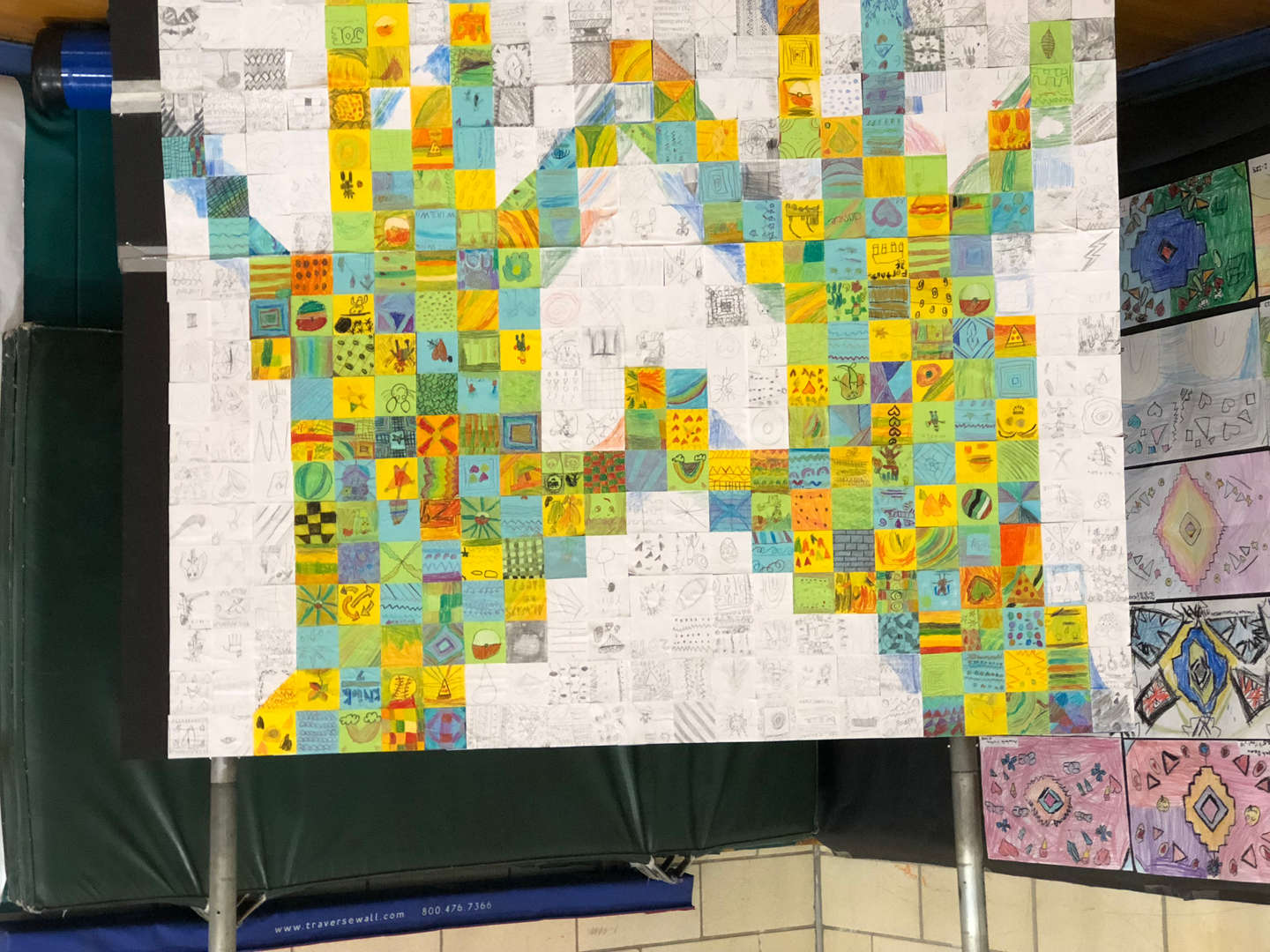 a collage of notes made by the students in the shape of two hands