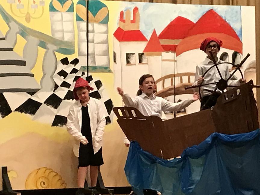 Three boys on a boat