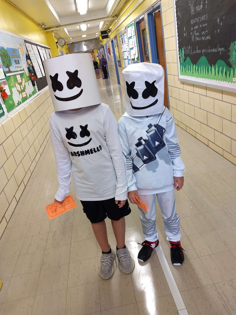 2 children wearing the same mask. So cute!