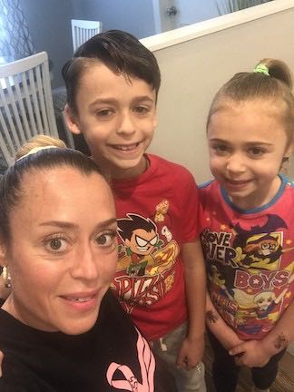 a teacher and 2 children wearing super hero tees