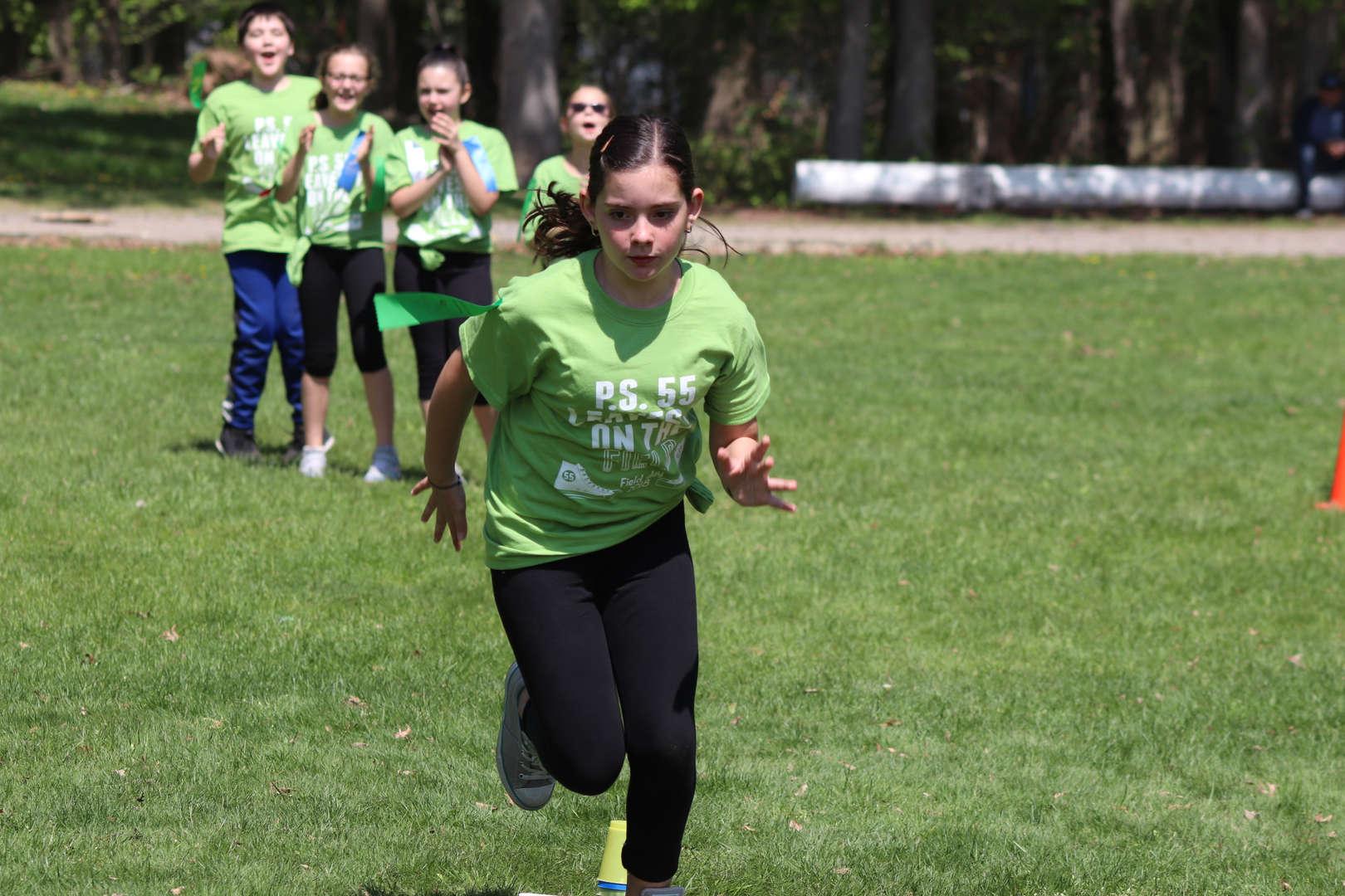 girl is running in her race