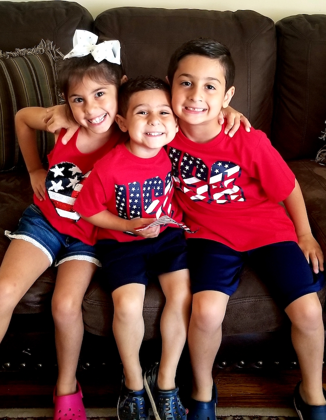 a family of brothers and a sister in red, white and blue
