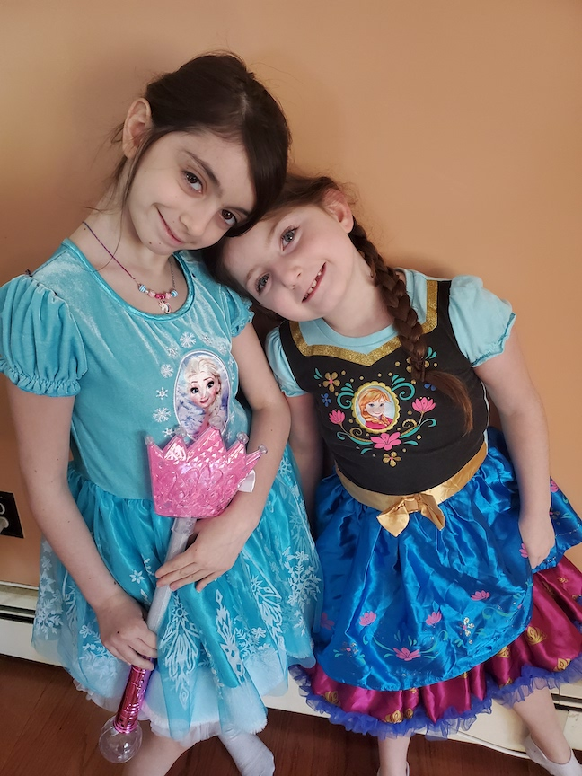 These two sisters are dressed like Elsa and Anna from Frozen