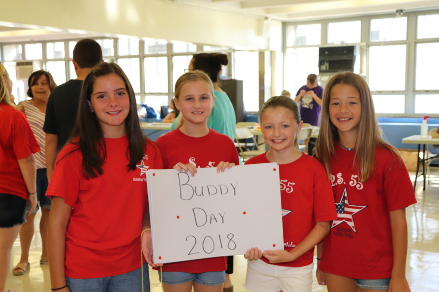 5th graders holding the Buddy Day sign