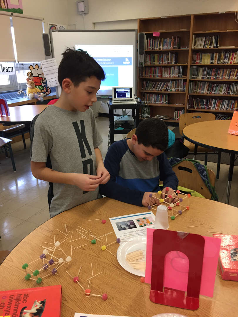 building a structure with gumdrops and toothpicks