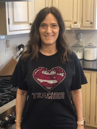 """This teacher's tee say """"Super Teacher"""""""