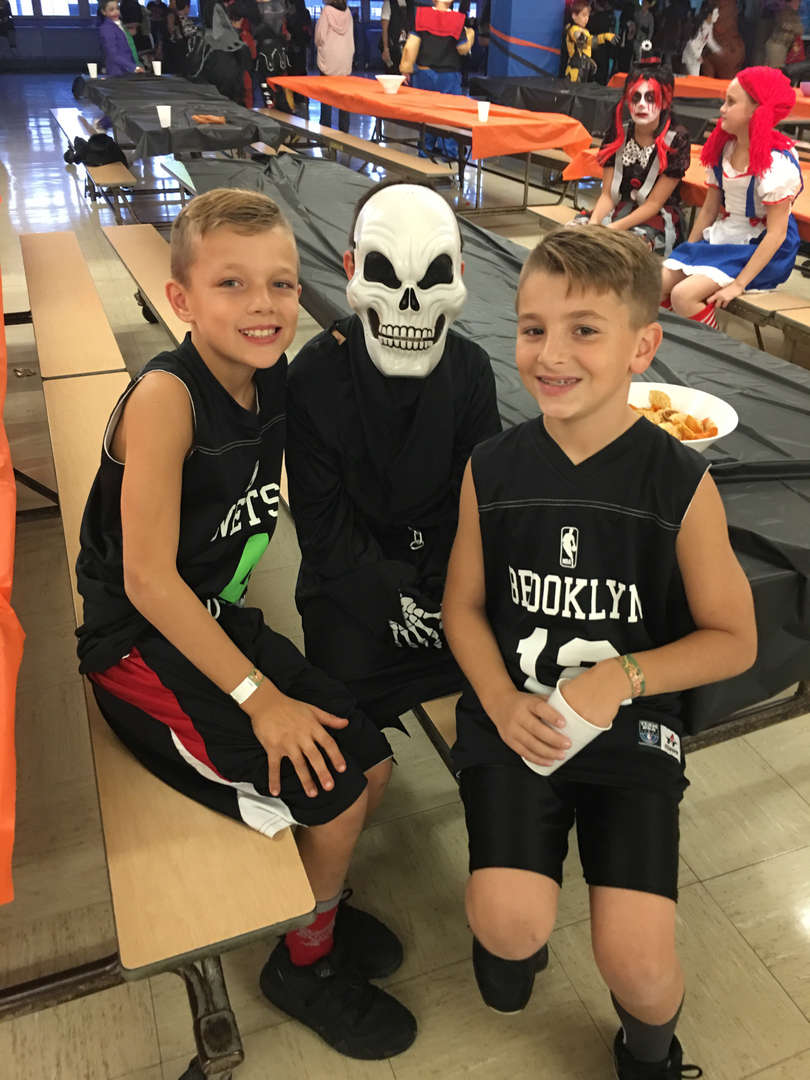 two boys and another dressed as a skeleton