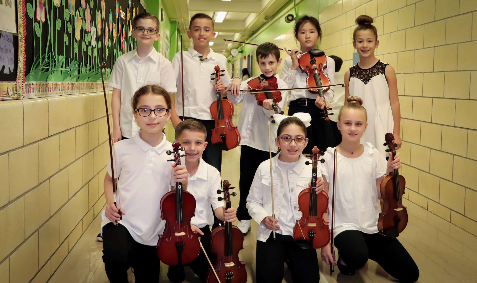 The violinists posing for a group picture