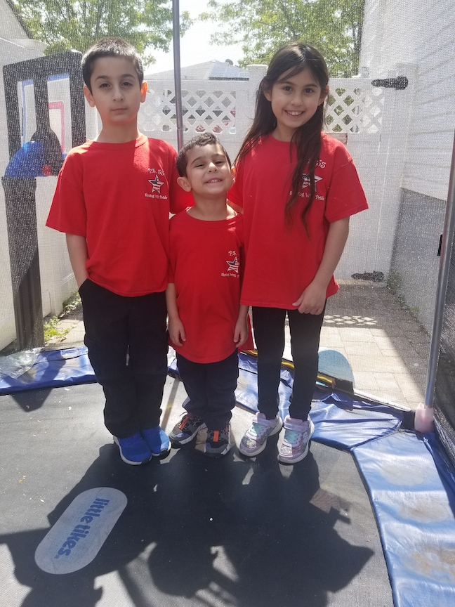 here are 3 children in their PS33 tees