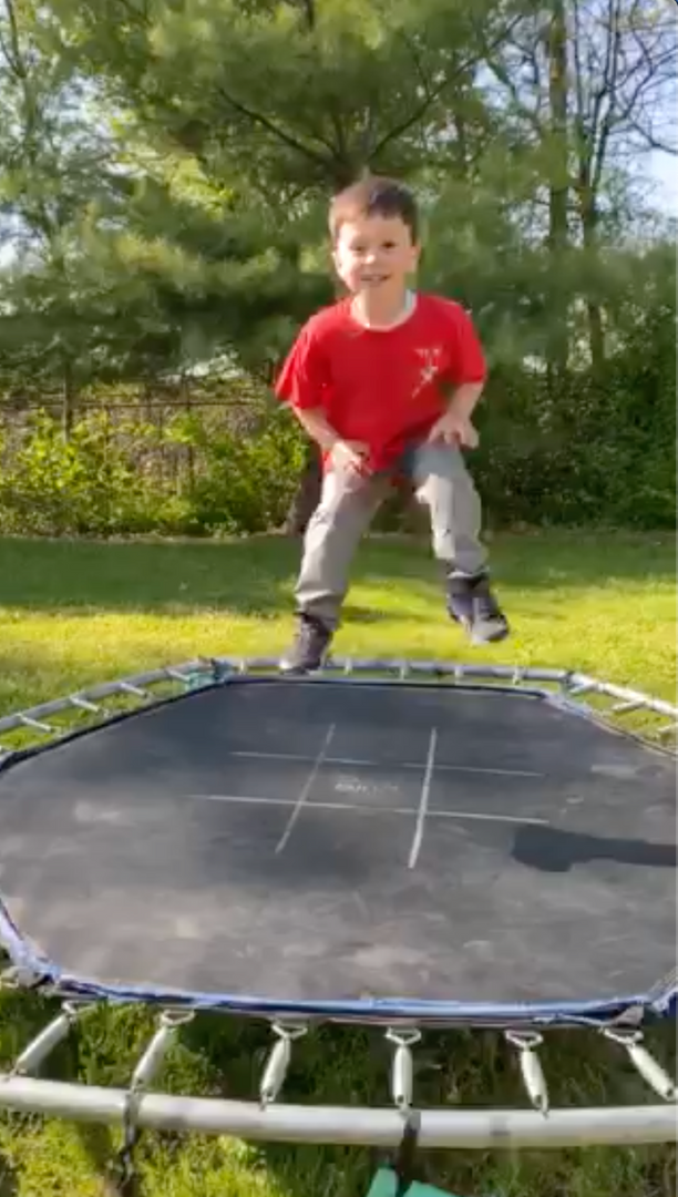 This child is jumping on a trampoline