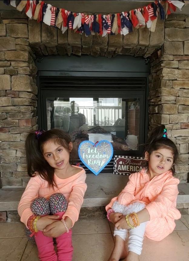 2 sisters wearing 80's hairstyles