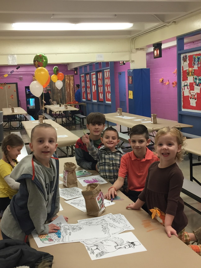 a group of boys coloring at the table